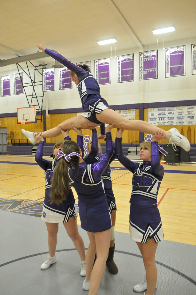 Walt Hester   Trail-Gazette<br /> Cheerleader Ernie Hardin practices a stunt with teammates before Tuesday's Meet the Bobcats event at the Estes Park High School. The event was a chance for the community to meet the winter sports teams.