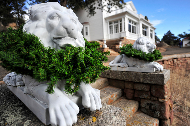 Walt Hester | Trail-Gazette<br /> Concrete lions adorn stairs on Saturday leading to the home once occupied by F.O. Stanley. The home was one of several featured in this year's Quota Club Holiday Home Tour.