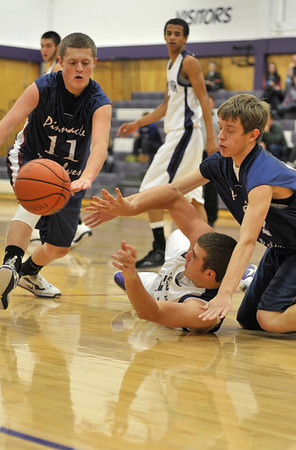 Walt Hester | Trail-Gazette<br /> Zach Eitzen dishes a pass from the floor in the fourth quarter. The Bobcats were not short on hustle in Monday's loss to Pinnacle.
