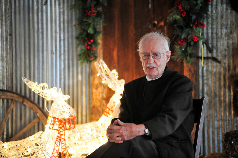 Walt Hester | Trail-Gazette<br /> Pieter Hondius sits amid western and holiday decorations on stage at the Elkhorn Lodge on Sunday. Hondius told stories of the early years of the lodge.