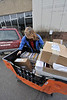 Walt Hester | Trail-Gazette<br /> Niki Barlow loads a large tub-full of mail into her car for delivery on Wednesday. The post office begins hitting their delivery stride soon with the holiday packages.