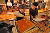 """Walt Hester   Trail-Gazette<br /> Scott Buck, 11, slams a door for effect during the WFAGR rehearsal of """"It's a Wonderful Life"""" on Tuesday. The production resembles and old radio theater production, complete with a table full of sound effects tools."""