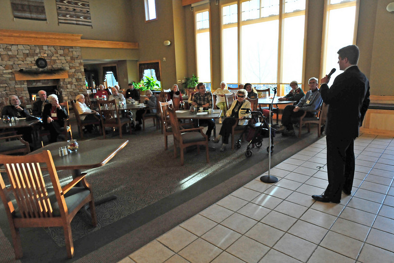 Walt Hester   Trail-Gazette<br /> Peter Fendel of Rep. Cory Gardner's office, addresses a crowd at the Good Samaritan assisted living facility on Wednesday. The event to meet newly elected officials was arranged by the League of Women Voters.