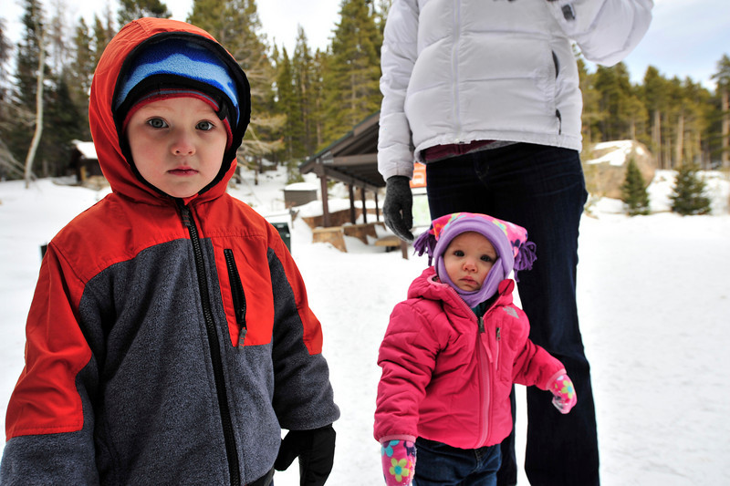 Walt Hester | Trail-Gazette<br /> Charlie, left, and Molly Washburn stand with their mother, Sarah, at the Bear Lake trail head on Tuesdy. The family was in the park to take holiday photos.