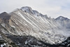 Walt Hester | Trail-Gazette<br /> High winds blow snow around Glacier Gorge and up the west slopes of Longs Peak and the Keyboard of the Winds on Wednesday. More snow could be headed toward Estes Park this weekend.