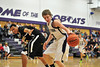 "Walt Hester | Trail Gazette<br /> Estes Park senior Gage Smith snatches the ball from Jefferson Academy's Bryson Sharpley during Wednesday's game. Smith, at 5'11"" was able to frustrate the taller Jaguars with his tenacity and speed in the 66-45 Bobcats' win."