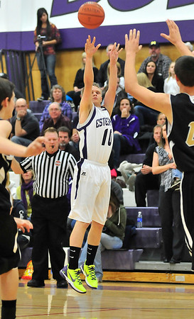 Walt Hester | Trail Gazette<br /> Taylor Marshall shoots and sinks one of four three-pointers in the third quarter against the Jefferson Academy Jaguars. Marshall and the Bobcats buried the Jags, 66-45.