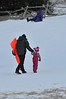 Walt Hester | Trail Gazette<br /> A father and daughter trudge up the sledding hill at the Hidden Valley Snowplay Area. Warm temperatures and strong, dry winds have depleated the area and the state's snow pack over the weekend.