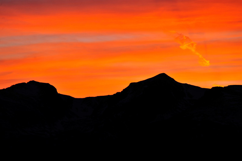 Walt Hester | Trail Gazette<br /> Wednesday's sunset turns the sky a vibrent orange over Otis and Hallett peaks.
