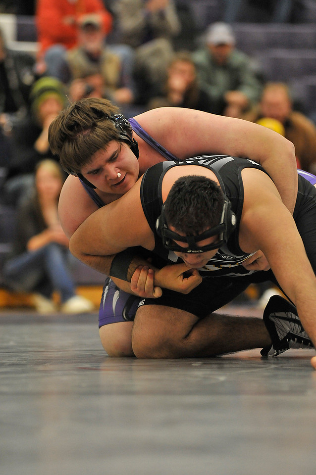 Walt Hester | Trail Gazette<br /> Estes Park's Ben Addison gets a grip on Valley's Roy Mendez in the 285-pound match on Thursday. Addison sufford a nose bleed, but it did not stop him from pinning the visiting Viking in the second period.