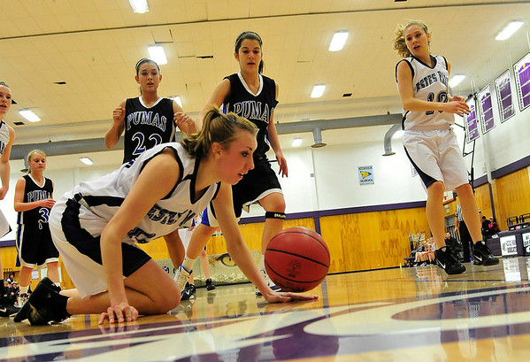 Walt Hester | Trail Gazette<br /> Amanda Dill can't quite get a handle on a loose ball against Peak to Peak on Saturday. The Ladycats built a sizable lead over the Pumas, only to watch it disappear in the second half.
