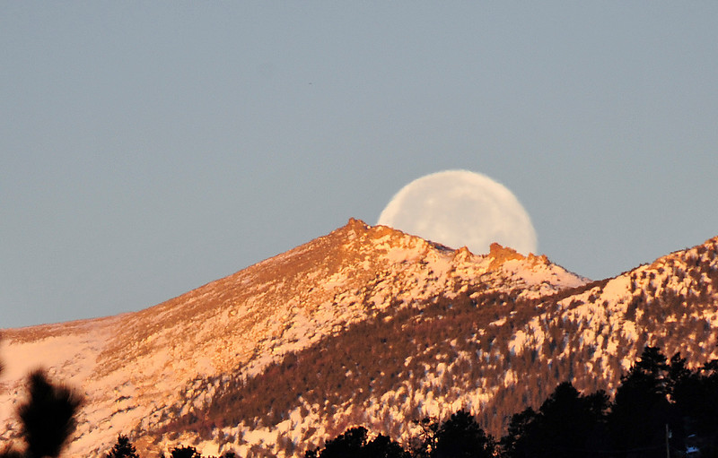 Walt Hester | Trail Gazette<br /> The full moon looks distorted in the early morning atmosphere on Tuesday. The earth's atmosphere is responsible for our moon seeming so large at horizons.