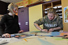 Walt Hester | Trail Gazette<br /> Alissa Olson, 13, left, and Autumn Burke, 13, work in pastels on a poster in their art class at the Estes Park Middle School on Wednesday. The pair made a poster depicting Montana.