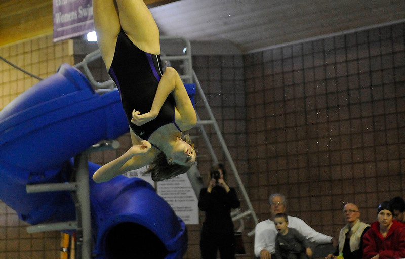 Walt Hester | Trail Gazette<br /> Ladycats diver Amelia Chew spins as family and fans watch during Tuesday's dual against Eaton. Estes Park's divers swept the top three spots, paving the way for the team's 109.5-77.5 victory.