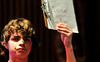 Walt Hester | Trail Gazette<br /> Seventh-grader Caden Brown holds up his answer during Friday's middle school geography bee. The bee, sponsored by National Geographic and Google, will eventually award one child a $25,000 scholarship, a lifetime membership in the National Geographic Society and a trip to the Galapagos Islands.