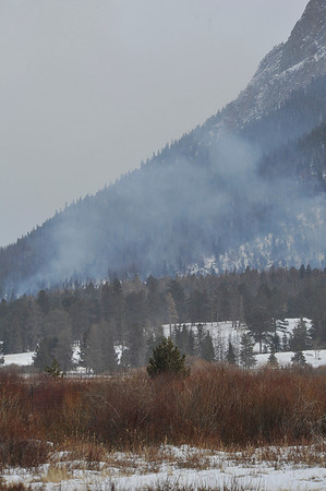 Walt Hester | Trail Gazette<br /> Smoke rises above the east end of Horseshoe Park on Wednesday as crews burn beetle kill and tree knocked down by November's wind storm. The park will conduct controled burns when conditions are right, often calm, cold days after snows.