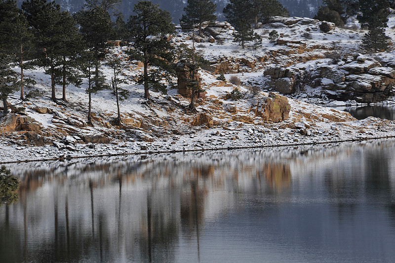 Walt Hester | Trail Gazette<br /> Reflections of trees, rocks and snow reflect off of the fridgid water of Mary's Lake on Wednesday. The lake's water rarely freezes because the water level constently changes.