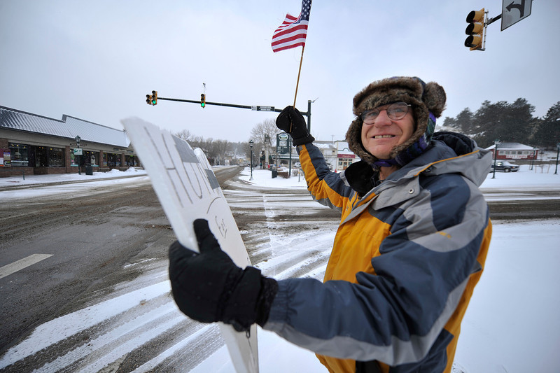 Walt Hester | Trail Gazette<br /> Patriot for Peace and Viet Nam veteran Randy Maharry is bundled up against Wednesday's cold and wind. The group is on their corner every Wednesday at noon, even when windchills dip to near zero.