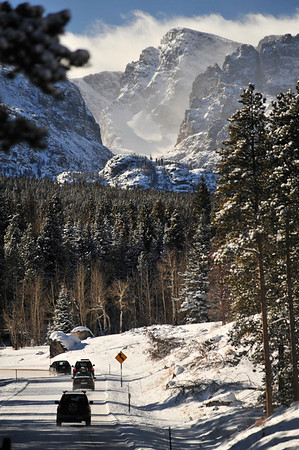 Walt Hester | Trail Gazette<br /> A line of visitors make their way up Bear Lake Road on Sunday. Bear Lake is the most popular snowshoeing destination in the park.