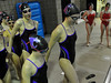 Walt Hester | Trail Gazette<br /> The Estes Park Ladycats swimmers prepare for warmup after the diving event on Tuesday. Traditionally, the Ladycats eneter the pool hand-in-hand as a show of solidarity, as well as to have a little light-hearted fun.