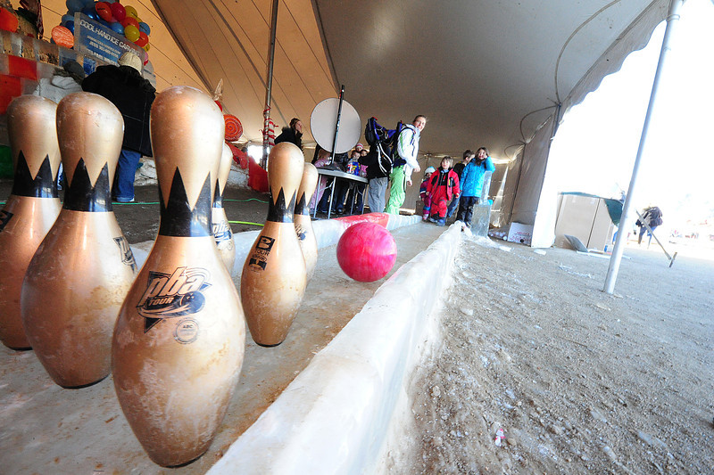 Walt Hester | Trail Gazette<br /> Families enjoy bowling on ice at the third annual Estes Park Winter Festival on Saturday. Children had the chance to skate, slide and climb at the festival.