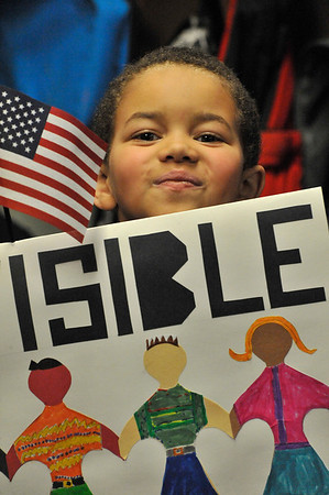 Walt Hester | Trail Gazette<br /> Chipper Banks, 6, peaks over the top of his sign at the annual Martin Luther King Jr. March at the Estes Park Elementary School on Friday. The march honors Dr. King's birthday and his vision.