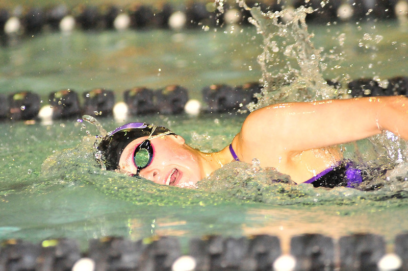 Walt Hester | Trail Gazette<br /> Emily Franklin makes her way toward a first-place finish in the 100 yard Freestyle aginst the Northridge Grizzlies on Tuesday. The Ladycats completely dominated the visiting Grizzlies, 136-46.
