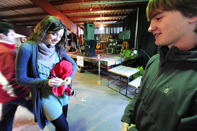 Walt Hester | Trail Gazette<br /> Hannah Holbrook, keyboardist of the band SHEL, autographs a CD for 14-year-old admirer Parker Hopkins at the Winter Festival on Saturday. The band, four talented sisters from Fort Collins, played a mix of rock and folk for the weekend.