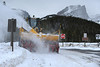 Walt Hester | Trail Gazette<br /> An enormous plow moves wind-blown snow off of the Bear Lake parking lot on Wednesday. With recent winds, not much snow is needed to creat an impassable drift.