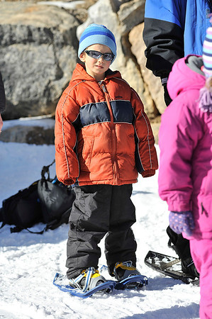 Walt Hester | Trail Gazette<br /> Dillon Marschel, 6, of Bailey waits for his parentsat the Winter Trails Day at the Bear Lake Road Park and Ride on Saturday. Retailers and manufacturers brought shoes of all sizes for enthusiasts to try.
