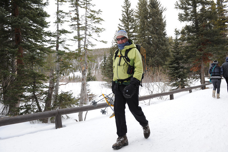 Walt Hester | Trail Gazette<br /> Ed Ogle of Loveland heads for the lot at Bear Lake on Wednesday. Cold and wind can't keep snowshoe enthusiasts away from the park's many snow-covered trails.