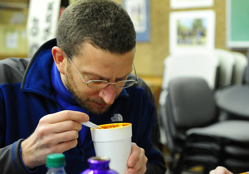 Walt Hester | Trail Gazette<br /> Danny Basch sniffs red chili during the competitive chili cook-off on Sunday. Fifteen red chilis and five green chilis were entered in Sunday's contest.