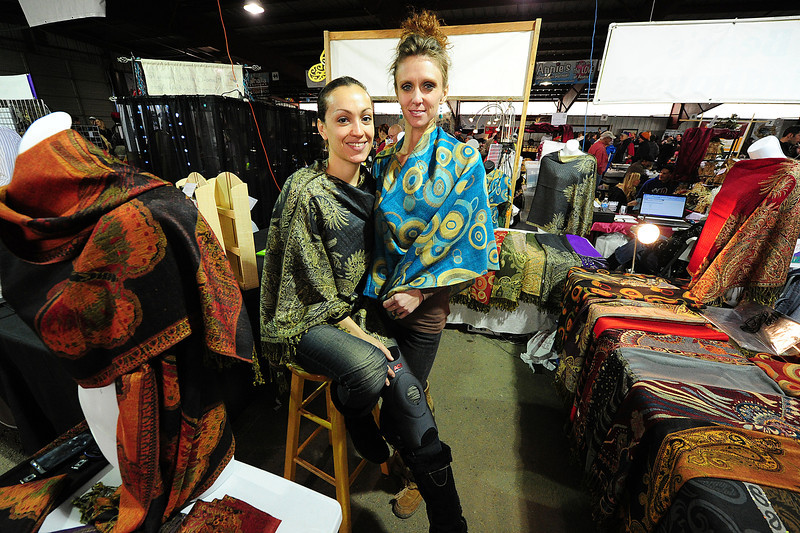 Walt Hester | Trail Gazette<br /> Veronika Londono, left, formerly of West Palm Beach, Fla., and Tirzah Sandt of Bailey display Shalls by Veronika at the Winter Festival on Sunday. Londono moved to Boulder hoping the cooler climbs could result in better sales.