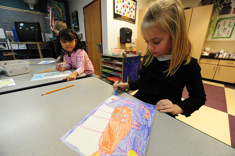 Walt Hester | Trail Gazette<br /> Myah Launer, 5, colors her kitten drawing in her art class on Wednesday. Children traced around their feet, then created an image based on the shape.