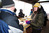 Walt Hester | Trail Gazette<br /> Nicole Arnold signs up and orients visitors to the annual Winter Trails Day on Saturday. The booth at the Bear Lake Park and Ride was the first thing visitors encounter when they visited.