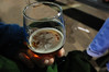 Walt Hester | Trail Gazette<br /> A snowflake shadow sits atop beer in the commemorative glass at the Estes Park Winter Festival on Sunday. The festival changes designs on the glass each year.