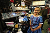 Walt Hester | Trail Gazette<br /> Caitlin Somerville, 9, of Longmont stands in her booth atthe Estes Park Winter Festival on Sunday. The little artisan made not only all of the jewalry, but her dress and that of her doll.