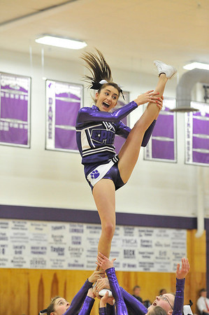 Walt Hester | Trail Gazette<br /> Estes Park cheerleader gets a kick out of firing up the crowd during Tuesday night's basketball game. The teams play again on Friday and Tuesday.
