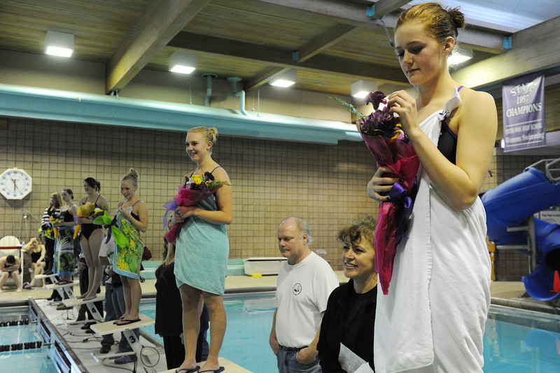 Walt Hester | Trail Gazette<br /> Senior swimmers, including Emily Franklin, line up for flowers and recognition on Tuesday. This year's seniors swimmers are, from right, Franklin, Carmen Laing, Hanna Steadman, Kassie Fisher and Erin Diedrich.