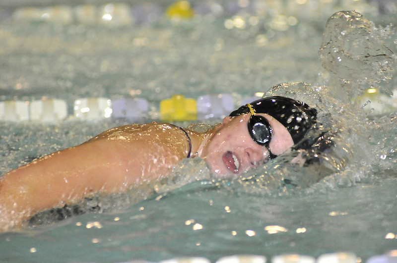 Walt Hester | Trail Gazette<br /> Emily Franklin glides to an easy win in the 500 yard freestyle in 6:03.07. The Ladycats needed every point as they took a close win over the Windsor Wizards on Tuesday, 105-81.