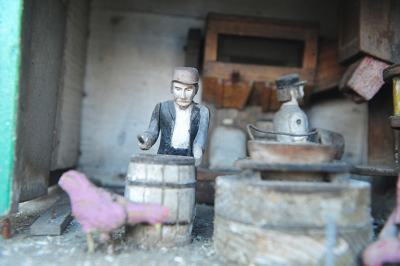 Walt Hester | Trail Gazette<br /> A miniature, mechanical miller awaits work in a display off of Elkhorn Avenue. Tucked away with the Wapiti Grill, the display also depicts a barroom and a traveling western show featuring Annie Oakley.