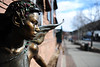 Walt Hester | Trail Gazette<br /> A bronze fairy watches traffic and pedestrians on Elkhorn Avenue. The sculpture, Voice in the Forest, by Victor Issa, sits at the door of the Old Church Shops.