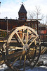 Walt Hester | Trail Gazette<br /> The water wheel on the Fall River sits at the far west end of the main shopping district on Elkhorn Avenue. The wheel sits below a clock tower that rings occasionally.