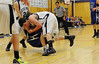 Walt Hester | Trail Gazette<br /> Ty Holler knocks down a Lyons player in a scramble for a loose ball during Tuesday nights match up. Holler and the Bobcats were not able to hang on long enough, giving up a 69-60 loss to the Lions.