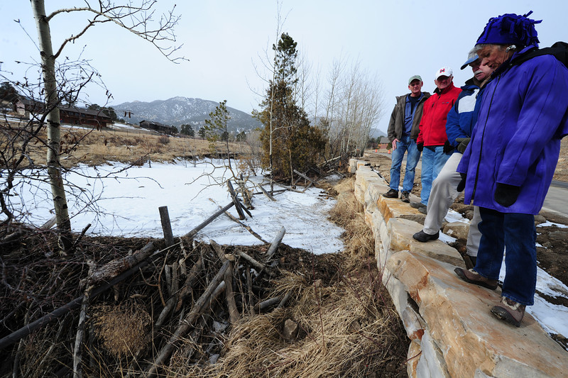 Walt Hester | Trail Gazette<br /> Interested parties inspect the wall on Friday that came out of a compromise that saved the beaver dam, at lower left. The Fish Creek trail is a little narrower than orginally planned, which will leave the beavers in the creek undisturbed.