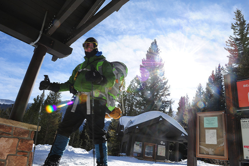 Walt Hester | Trail Gazette<br /> Travis Steele of Fort Collins returns to the Bear Lake Trail Head on Wednesday after a night camping at 10,600 feet, near Joe Mills Mountain. Estes Park is hoping to attract more winter visitors if the state approves the Elkhorn Project.