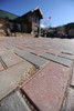 Walt Hester | Trail Gazette<br /> One of many broken paving stones awaits replacement in front of Town Hall on Wednesday. The town has made an agreement with the contractor to repair the short stretch of MacGreggor Avenue.