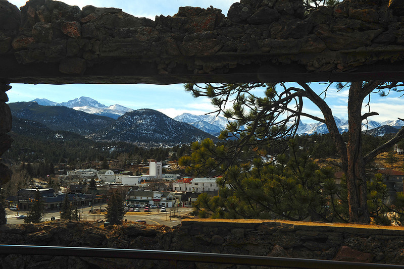 Walt Hester | Trail Gazette<br /> The Front Range spreads out through the window of the ruins atop the Knoll above downtown Estes Park on Monday. The Birch Ruin, built for Denver newspaperman Al Birch, burned within a year of its construction in 1907.
