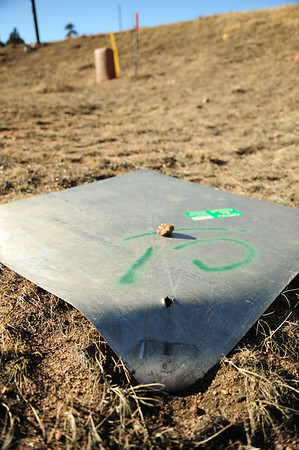 Walt Hester | Trail Gazette<br /> A hole in a traffic sign shows where a bolt once held it to a post along South St. Vrain Avenue before being ripped of and deposited down hill. Winds buffeted the Estes Park area over the weekend causing minor damage.