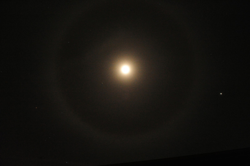 Walt Hester | Trail Gazette<br /> High thin clowds creat a halo around Wednesday night's moon. Superstition suggests the halo is a harbinger of snow, which may actually be the case on Friday.